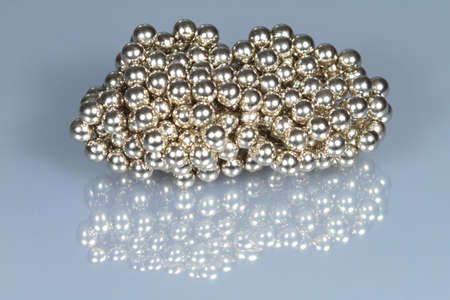 steel balls: Steel balls are on a reflective surface  Stock Photo