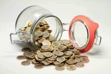 distributed: From a jar euro coins are distributed