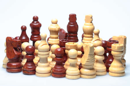 Against a white background is a set of chess pieces  photo
