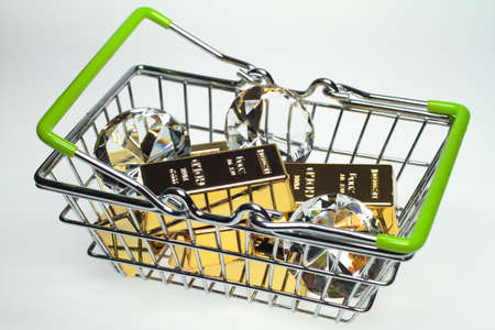 In a shopping basket are six gold bars and three diamonds  photo