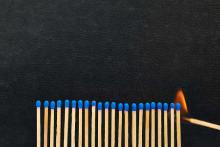 A series of matches are next to each other, which burn one after another  Stock Photo - 22089047