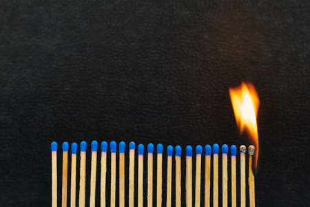 A series of matches are next to each other, which burn one after another  Stock Photo - 22089050
