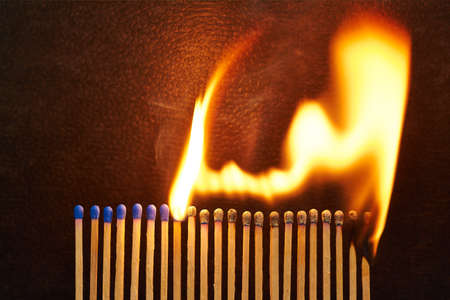 A series of matches are next to each other, which burn one after another  Stock Photo - 22089055
