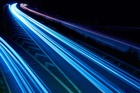 On the night propelled at a long exposure light trails produce cars with their headlights  photo