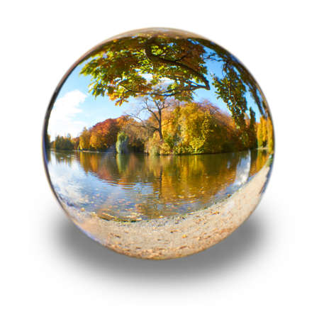 In a glass ball can you seen the landscape behind her  Banco de Imagens