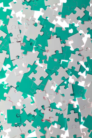 messed: White and colored puzzle pieces are messed up