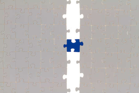 Two white puzzle halves are connected by single-color puzzle piece