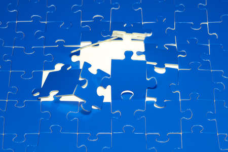A puzzle with a hole located on a white background  Stock Photo