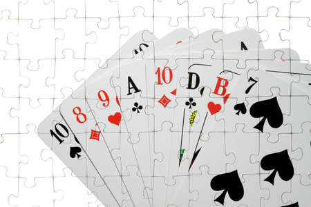 skat: On a puzzle several playing cards are shown  Stock Photo