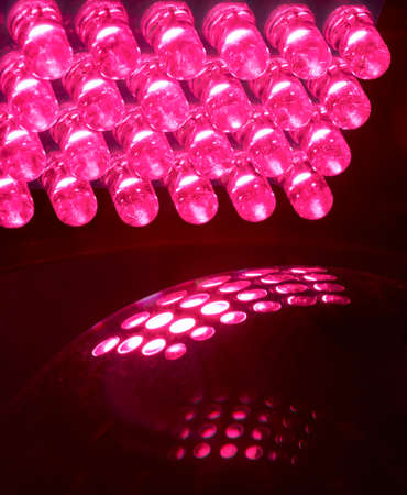 leds: An array of 24 LEDs light up a glass ball  Stock Photo