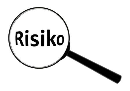 risiko: A magnifying glass against white background increases the word Risiko. Stock Photo