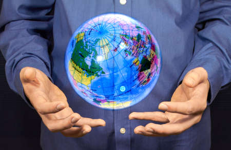 hovering: A magic globe hovering above two hands. Stock Photo