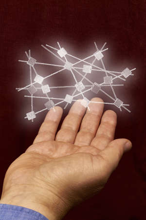 A white network hovers above a hand. photo