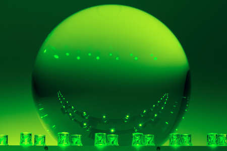Two rows of LEDs light on a glass ball. photo