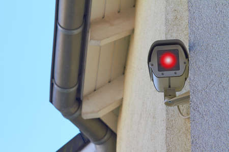 A new security camera is mounted on a wall. photo