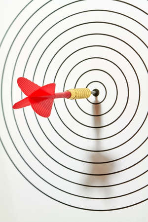 darts flying: A target was hit by a dart in the center.
