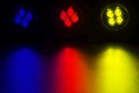 leds: Bright LEDs shine on a surface in the foreground.