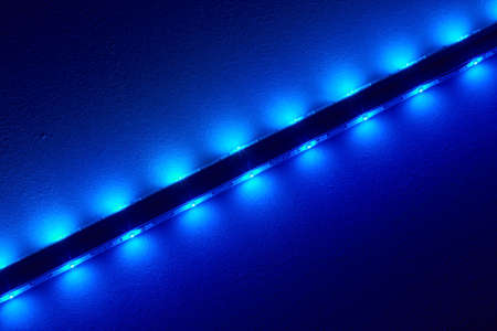 lightbar: Bright LEDs at a bar illuminate the ceiling.