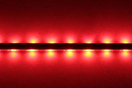 leds: Bright LEDs at a bar illuminate the ceiling.