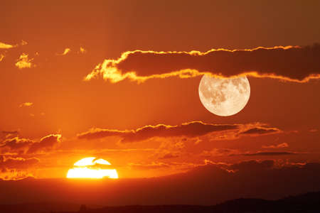 sky: The sun and the moon can be seen in the sky Simultaneously. Stock Photo