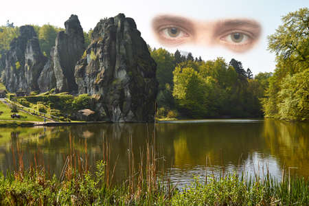 mountain peek: Eyes look at the Externsteine, a distinctive rock formation in the Teutoburg Forest in Germany.