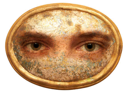 voyeur: Two eyes in a golden oval plate.