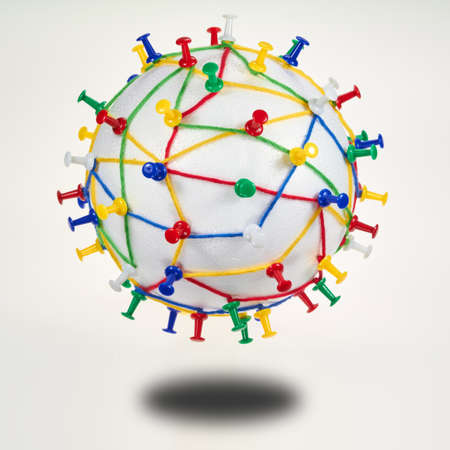 dataflow: Colorful wool threads on a globe form a network between pins.