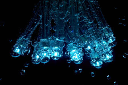 leds: LEDs with gas bubbles are dipped in mineral water.