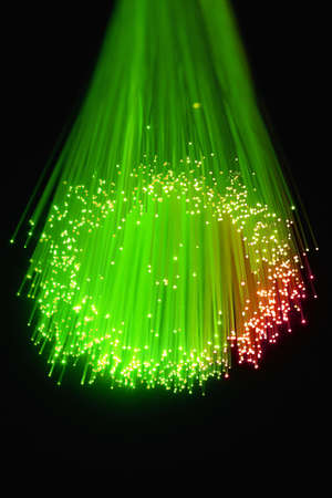 fiber optic lamp: Optical fiber produce in the darkness a circle with Points of Light in the air.