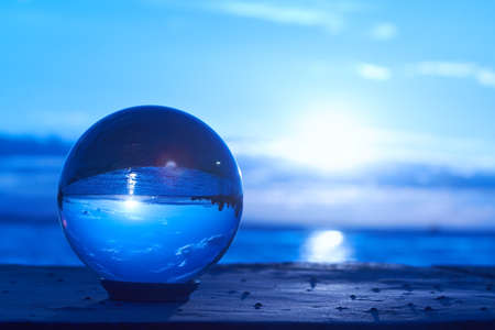 crystal glass: The sun sets over Lake Constance in Germany and lit by a crystal ball.