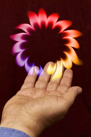 licking finger: A ring of flames floating above a hand. Stock Photo