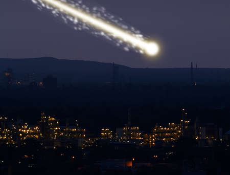 meteorites: A large bright meteorite is dragging a long trail of light across the sky.