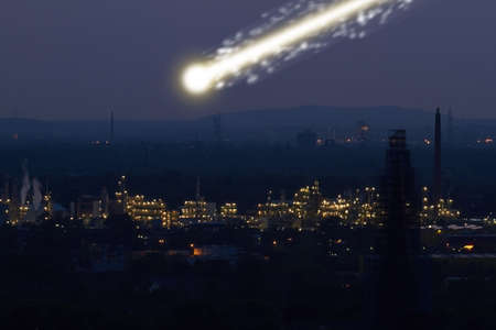A large bright meteorite is dragging a long trail of light across the sky.