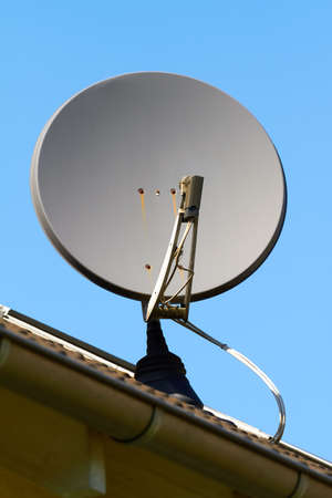 parabolic mirror: Satellite dish on the roof of a house.