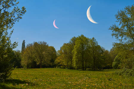 moons: Two moons are above at idyllic landscape.