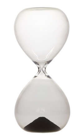 Hourglass for measuring time of one minute in front of white background. Stock Photo