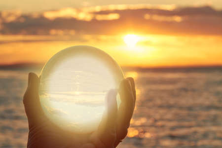 The sun sets over Lake Constance in Germany and lit by a crystal ball.)