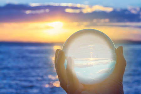clairvoyance: The sun sets over Lake Constance in Germany and lit by a crystal ball.)