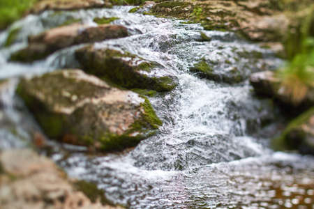 rocks water: Quick over rocks water flowing in a stream. Stock Photo
