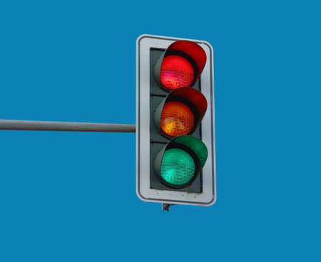 At a traffic light the three colors light up red, yellow and green at the sametime.