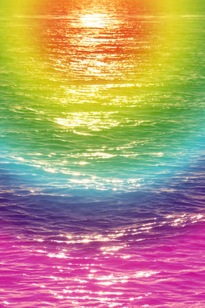 dynamically: Sun rays reflected on a water surface in motion.