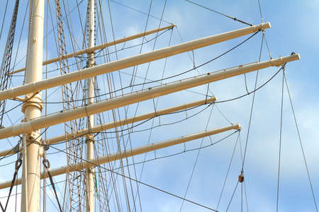 Mast of a large sailing ship against a blue sky. Stok Fotoğraf
