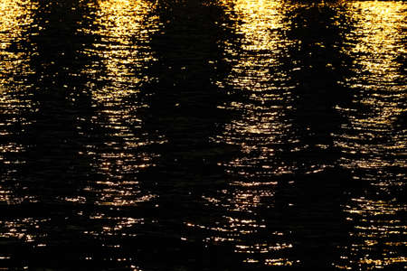 Light rays reflected on a water surface in motion. Stock Photo