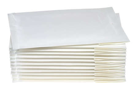 A stack of envelopes in front of white background. Stock Photo