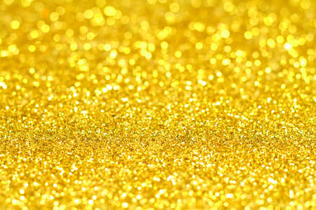 Background with tiny plastic tiles that glitter in bright light. Stock Photo