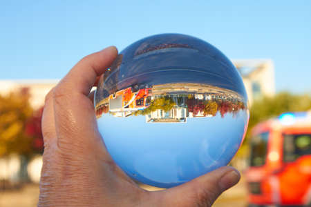 The Federal Chancellery in Berlin viewed through a glass ball.