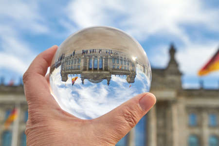 The Reichstag building in Berlin viewed through a glass ball.