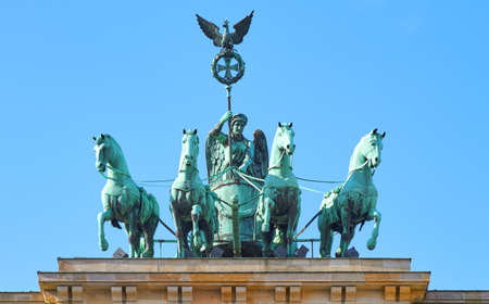 The Quadriga stands on the Brandenburg gate in Berlin.