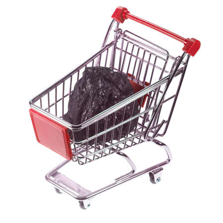 There is a piece of coal in a shopping basket. Stok Fotoğraf