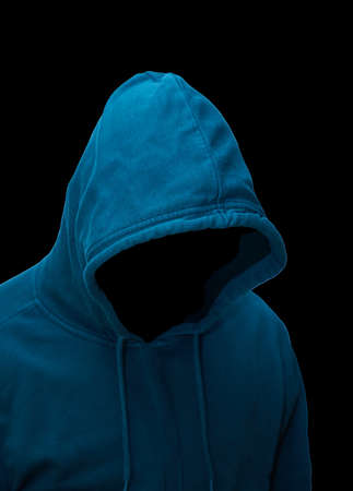 Dangerous hacker with hooded sweater against a black background.